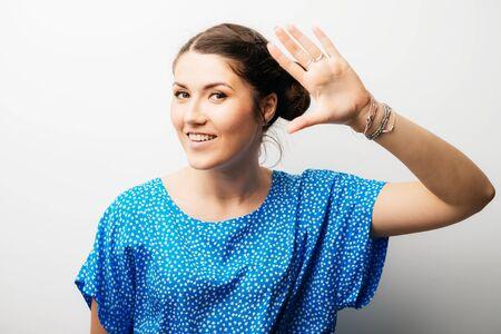 girl showing hello Stockfoto