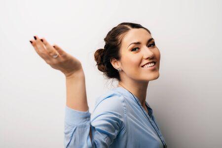 Pretty brunette girl holding something on her hand