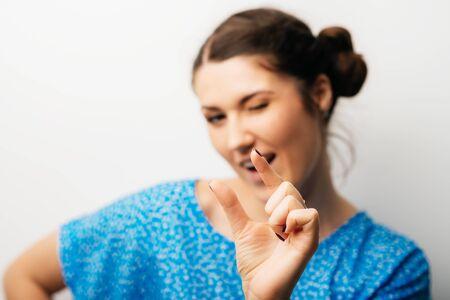 girl shows that something is not enough 版權商用圖片