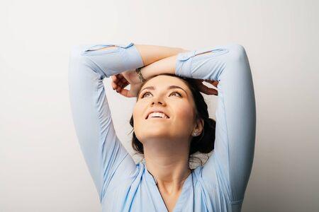 Pretty girl stretching after sleep 版權商用圖片