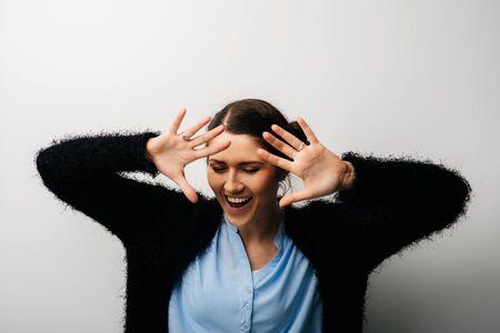 girl laughing gesticulating 版權商用圖片