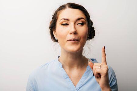 girl shows the index finger up