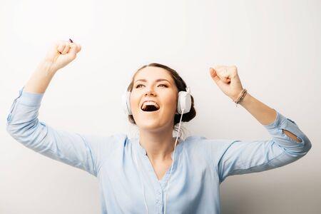 girl in headphones dancing