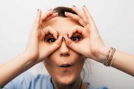 Pretty brunette girl shows glasses hands 版權商用圖片