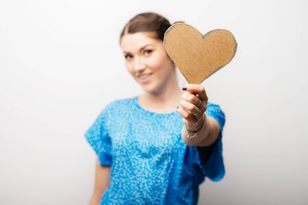 girl holding a paper heart