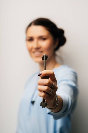Pretty brunette girl holding keys in his hand