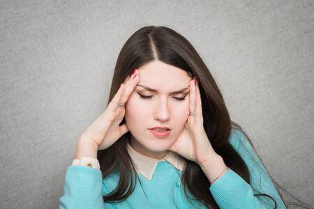 the girl has a headache