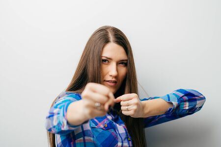 Young woman showing fists