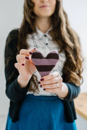 girl hold homemade Heart