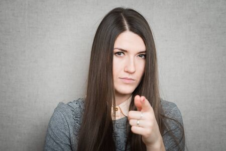 young  woman pointing at someone gesture with finger 版權商用圖片