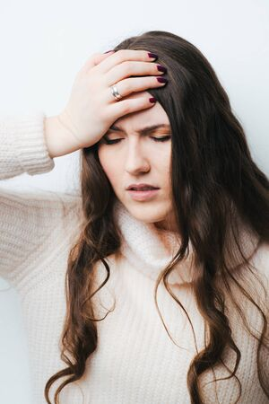 on a white background young girl with long hair upset Reklamní fotografie
