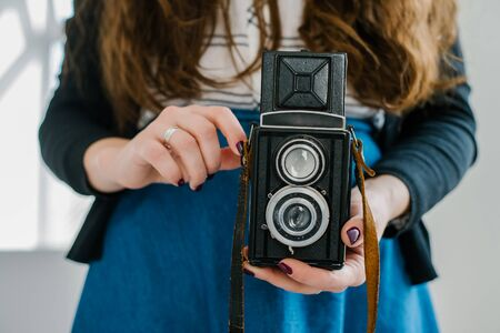 Woman photographer with old lomo camera.