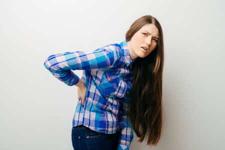 on a white background a young girl back pain