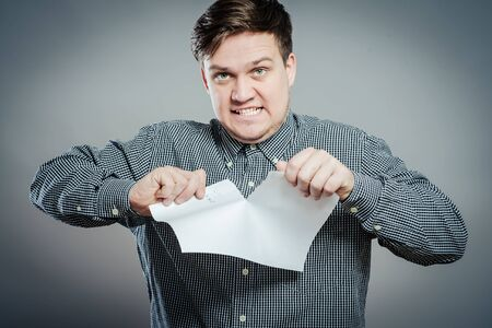 Angry man tear out paper