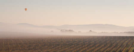 Hot Air Balloon at Sunrise over the Yarra Valley In Winter photo
