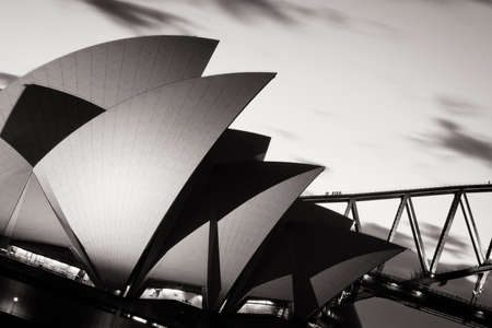 The sun sets over Sydney Harbour in Sydney, Australia 写真素材
