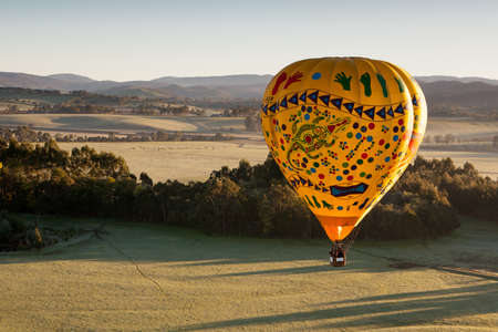 A sunrise hot air balloon flight over the Yarra Valley in Victoria, Australia