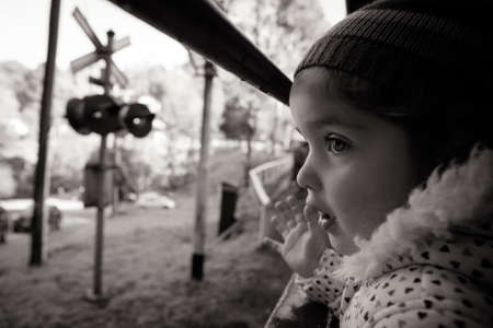 puffing: A young girl looks out of a window on the Puffing Billy steam train in Melbourne, Victoria, Australia