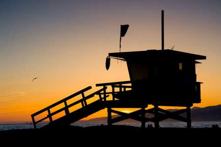 cityscape silhouette: Sunset thru a lifeguard tower near Santa Monica in Los Angeles, USA