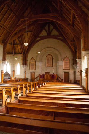pews: The beautiful interior on a sunny day of Ross Uniting Church in Ross, Tasmania