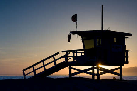 Sunset thru a lifeguard tower near Santa Monica in Los Angeles, USA photo