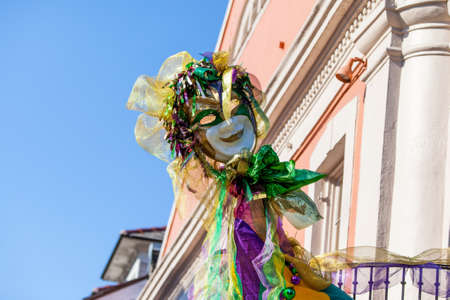 A resident of the French Quarter in New Orleans decorates their home with Mardi Grad colors