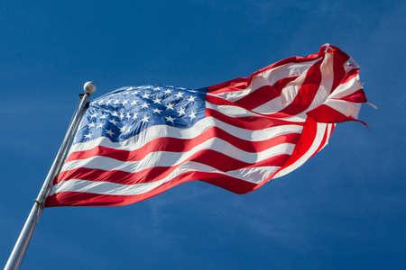 louisiana flag: A USA flag flies in a strong wind in Louisiana, USA