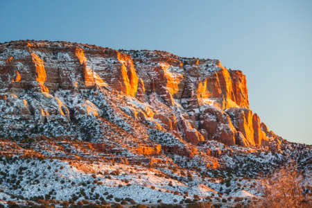 Sunset in Zuni, New Mexico on a rock face in New Mexico, USA photo