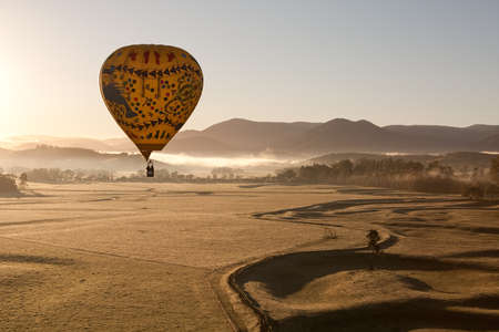 A sunrise hot air balloon flight over the Yarra Valley in Victoria, Australia photo