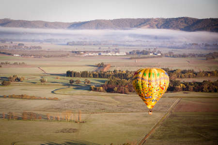 A sunrise hot air balloon flight over the Yarra Valley in Victoria, Australia Фото со стока