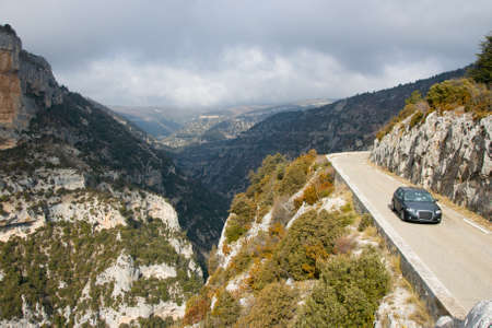 A car makes its way around winding roads in Provence, France photo