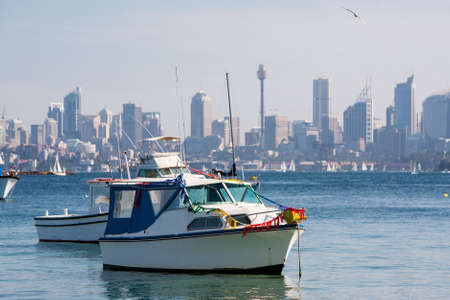 centrepoint tower: Yachts are anchored in Sydney Harbour near Watson Stock Photo