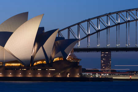 Sydney Opera House with passing boat traffic at dusk in Sydney, Australia