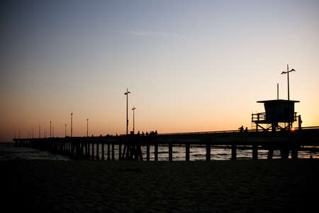 Venice Beach pier at sunset on a warm day in Los Angeles, California, USA photo