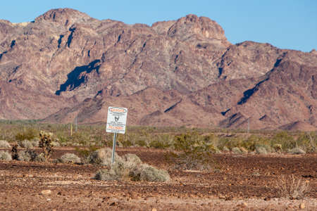 landmine: Danger signs for landmines  and ammunition on Highway 95 near Yuma, Arizona, USA Stock Photo