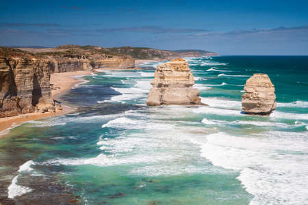 Some of the Twelve Apostles shine in the afternoon sun on a hot summers day near Port Campbell, Victoria, Australia