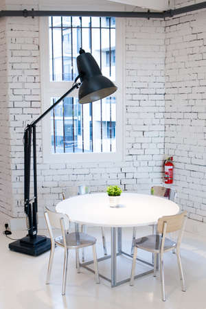 A modern table, chair and lamp.