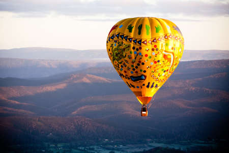 A sunrise hot air balloon flight over the Yarra Valley in Victoria, Australia 写真素材