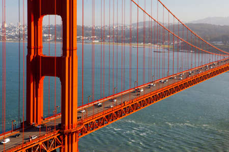 A view at midday thru the Golden Gate Bridge towards downtown San Francisco  IN California, USA