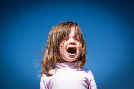 A child cries on a hot summer 写真素材