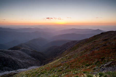 The view at sunset from the summit of Mt Buller towards Mansfield in the Victorian High Country, Australia