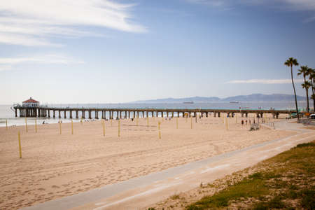 Manhattan Beach and pier on a warm sunny day in Los Angeles, California, USA photo