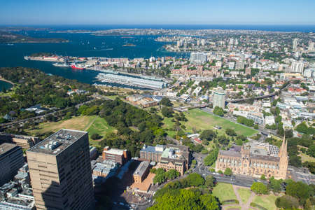 A clear sunny day in Sydney, looking east over Hyde Park at St Mary's cathedral. photo