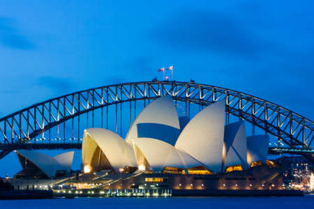 Sydney Opera House and bridge at dusk in Sydney, Australia Editorial