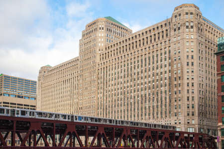 The Merchandise Mart and a train on a clear winter