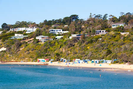 swiming: People at the beach on a hot summers afternoon in Mornington, Victoria, Australia