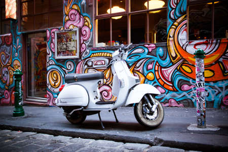 Melbourne, Australia - December 20 - Melbourne's famous Hosier Lane with motorcycle and graffiti on December 20th 2013. 報道画像