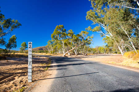 resulted: A period of drought has resulted in this dry river creek bed near Ormiston Gorge, Northern Territory, Australia Stock Photo