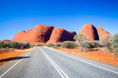 The Olgas and nearby roadscape in the Northern Territory, Australia Фото со стока