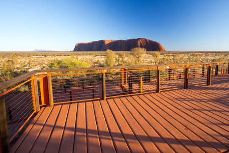 uluru: Majestic Uluru and the viewing platform at sunrise on a clear winters morning in the Northern Territory, Australia